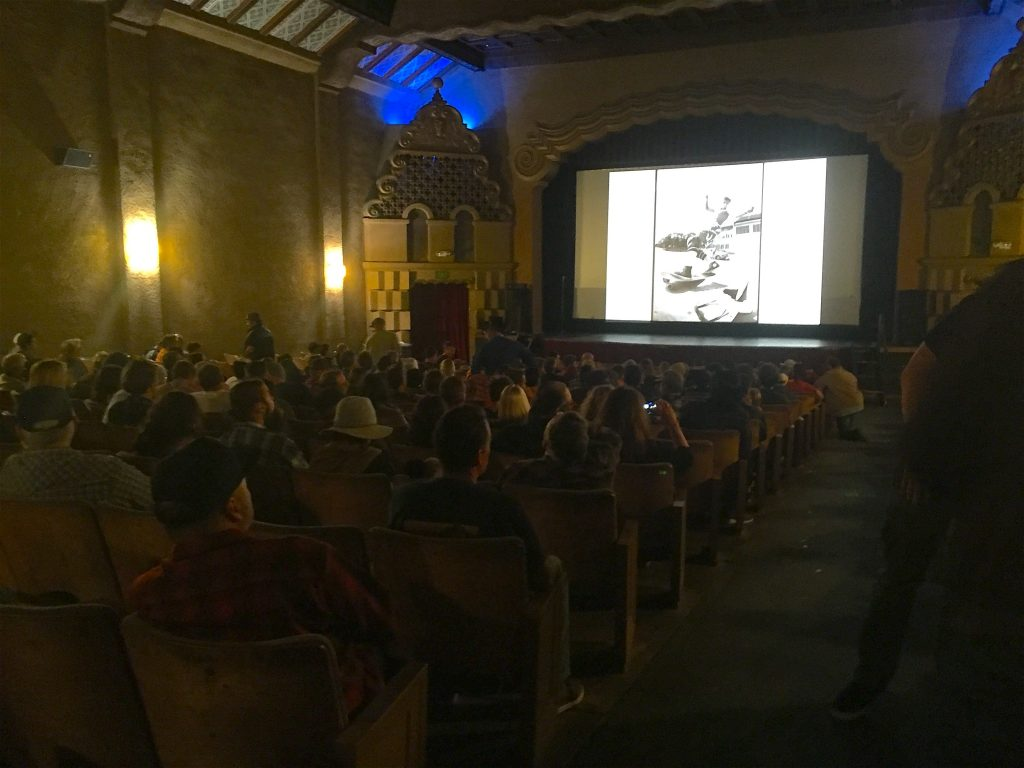 Grant's work displayed to a packed theater prior to the show
